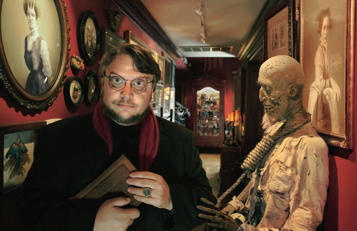 Film director Guillermo del Toro sourronded by his own archive of the extraordinaire